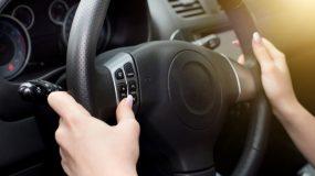 Female hands on steering wheel